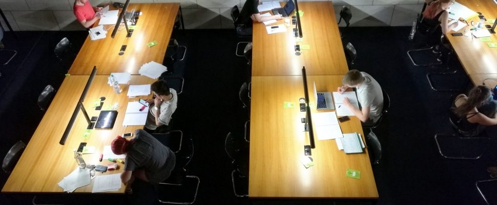 Students in a library, about dts
