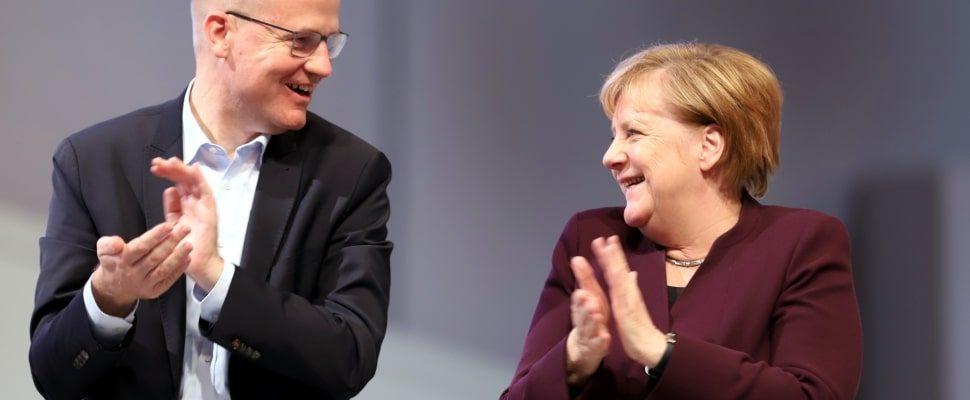 Ralph Brinkhaus and Angela Merkel, about dts